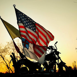 Sometimes the flag just seems to pose by William Boyea - Transportation Motorcycles ( flags, bike, pole, sunset, art )