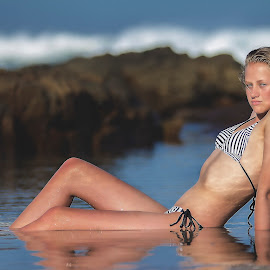 Reflection by Phillip Prinsloo - People Fashion ( water, reflection, model, nature]natural light, waves, swimwear, sea, reflections, bikini, portrait, swimsuit, rocks, natural )
