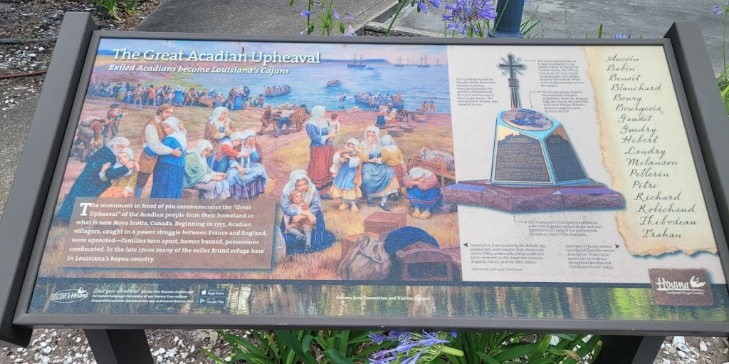 - Exiled Acadians become Louisiana's Cajuns -The monument in front of you commemorates the