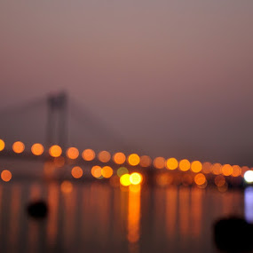 City lights bokeh by Somsubhra Chatterjee - Buildings & Architecture Bridges & Suspended Structures ( kolkata, sunset, bridge, bokeh )