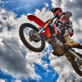 King Of The Airs by Marco Bertamé - Sports & Fitness Motorsports ( clouds, flying, red, wheel, motocross, speed, cloudy, race, blue grey, noise, overflying, jump )