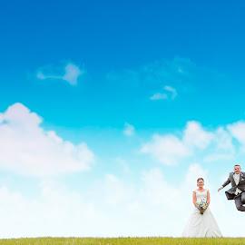 Jump4Joy by Andy Jones - Wedding Bride & Groom ( contemporary wedding photography, uk, somerset, sky, negative space, wedding, bride and groom, minimalist )