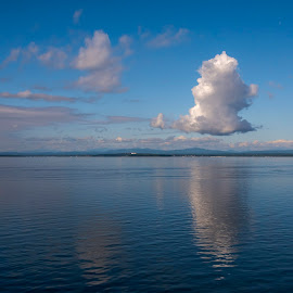 Early morning puffy clouds on the lake by Debora Garella - Landscapes Cloud Formations ( clouds, lake champlain, adirondack mountains, adirondack, vt )