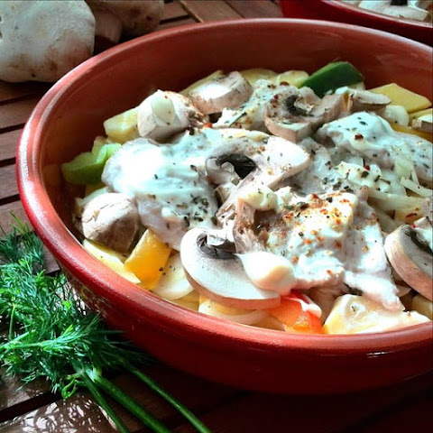 Pork Baked With Vegetables And Mushrooms.