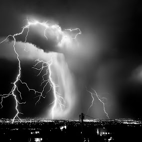 A Light Shower by Roch Hart - Landscapes Cloud Formations ( clouds, thunderstorms, mono-tone, b&w, thunderstorm, black and white, black and white collection, monotone, landscape, storm, night scape, new mexico, city, lightning lightning storm, albuquerque, city lights, b and w, night, light, rain )