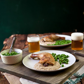 Roasted Beer Brined Chicken Legs over Grilled Corn Puree and English Pea Herb Salad