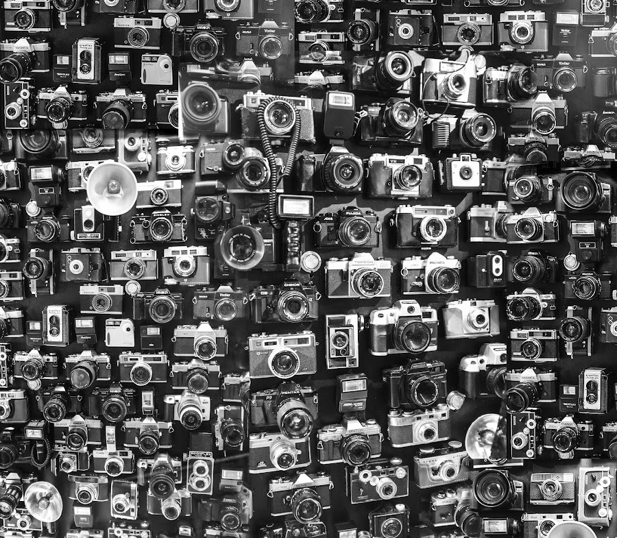 Obsession. by Rob Jarvis - Products & Objects Technology Objects ( film, canon, flash, lenses, b&w, art, camera, 35mm, white, hobby, black and white collection, object, collection, lens, photo, obsession, fuji, nikon, passion, black )