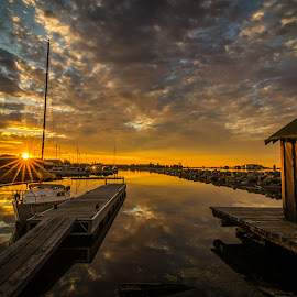 Marina Sunburst by David Johnson - Landscapes Sunsets & Sunrises ( clouds, sunburst, fish house, marina, sunrise )