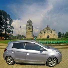 Silver and Shiny by Lois Caronongan - Transportation Automobiles ( ride, pathway, wheels, silver, bell tower, enjoy, travel, north, architecture, transportation, scenic, stills, sky, blue, bricks, action camera, perfect weather, bue, mobile )