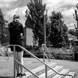The Wait by Ernie Kasper - Instagram & Mobile iPhone ( railing, instagram, person, black and white, waiting, candid, steps, instapic, baseball cap, stairs, thinking, metal, patience, shorts, bnw )