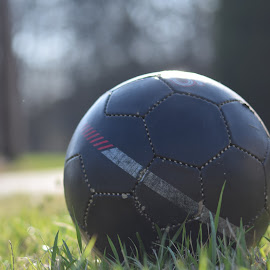 Kicked Around by Susan Myers - Sports & Fitness Soccer/Association football ( ball, soccer ball, bokeh )