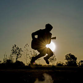yeehaaaw! by Barbara Springer - People Musicians & Entertainers ( sunset, silhouette, musician, guitar, jump,  )