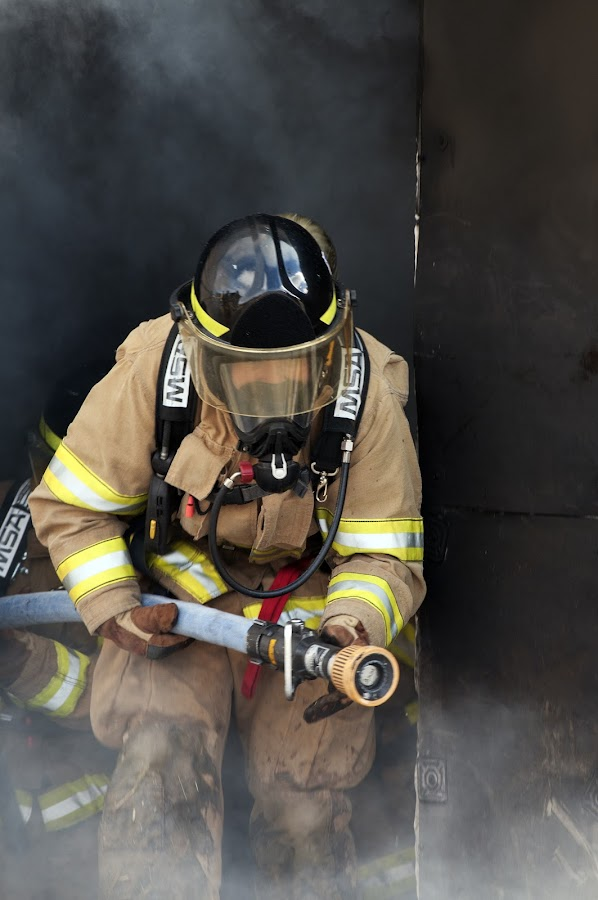 fire fighter training by Kelvin Watkins - Professional People Law Enforcement ( hose, helmet, black, smoke )