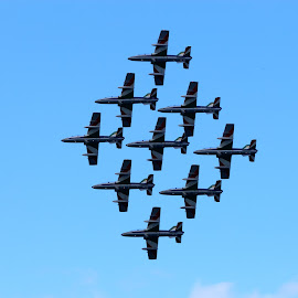 Showing off by Quel Mirhan - Transportation Airplanes ( sky, pilots, plane, colors, formation )