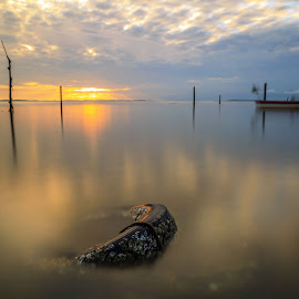 Beautiful sunrise at Ag Aru beach. Labuan by Daimasala Abdullah - Landscapes Waterscapes ( show, house, beach, travel, heat, people, asian, borneo, sabah, water scape, sky, nature, village, malaysia, tourism, sea scape, vacation, horizontal, beach party, gypsy, labuan, coral, nomadic, tropical, scenicsea, ocean, beauty, landscape, sun, island, clear, life, happy, sunny, asia, less, water, sand, peaceful, romantic, crystal, boat, paradise, wooden, sunset, background, cloud, summer, scenery, sunrise, pillars )