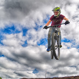 by Marco Bertamé - Sports & Fitness Other Sports ( clouds, red, blue, jumpflying, cloudy, grey, air, dow, bicycle )