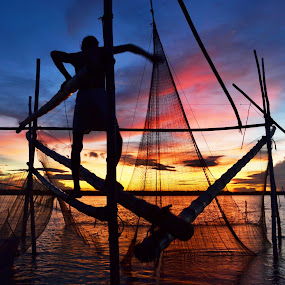FISHING AT SUNSET 6 by Dipankar Singha - Landscapes Sunsets & Sunrises