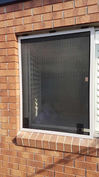 Wallan_Security_Doors_push_out_window_grill_closed