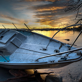 After the Storm by Jerry Kambeitz - Transportation Boats ( orange, wreck, ocean, sunrise, sailboat )