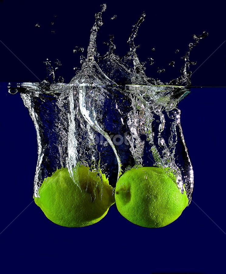 sparkling lemon. by Pete G. Flores - Food & Drink Fruits & Vegetables ( blue, yellow, lemon food fruit vegetables drop water otep splash sparkling )