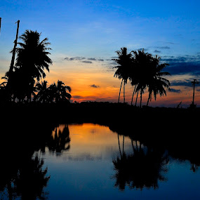An Indian Sunrise by Prasant Kumar - Landscapes Sunsets & Sunrises ( water, reflection, red, nature, pwcreflections, trees, sunrise, landscape )