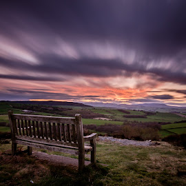 Bench on the hill  by John Haswell - Landscapes Prairies, Meadows & Fields ( clouds, hill, bench, long exposure, colours )