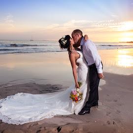 The Kiss by Bernardo Garcia - Wedding Bride & Groom ( bouquet, kiss, colors, sunset, wedding, beach, bride, groom )