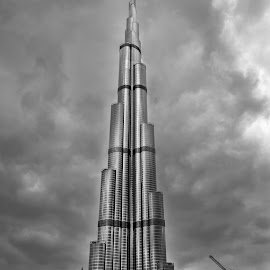 Burj Khalifa in Dubai by Péter Mocsonoky - Buildings & Architecture Other Exteriors ( clouds, famous, architecture, city, landmark, urban, dubai, khalifa, uae, wonder, burj, high, big, united arab emirates, downtown, tall, black )