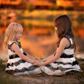 Holding Hands by Nicole Ferris - Babies & Children Children Candids ( siblings, warm, reflection, outdoors, sisters, girls, water, lake )