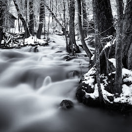 It flows by Juho Mäkinen - Landscapes Waterscapes ( water, winter, cold, ice, snow, finland, forest, long exposure, woods, river )