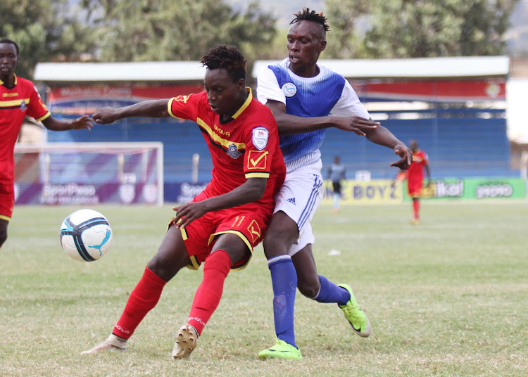 MT Kenya's John Ndirangu and Michael Oduor of Sofapaka vie for the ball during a recent match