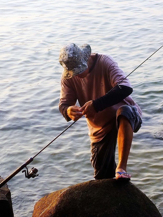 Adjusting His Baits at Changi Beach by Alan Chew - News & Events World Events (  )