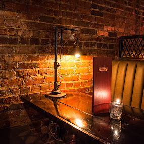 Watts and Ward by Thomas Shaw - Buildings & Architecture Other Interior ( bricks, north carolina, city, nightlife, restaurant, downtown, raleigh, booth, bar, light, candle, place, table, photography )