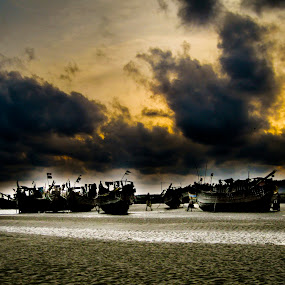 an unusual parking lot! by Rajarshi Mitra - Transportation Boats ( clouds, sunset, boats, beach, drama )