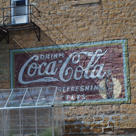 Advertisment  by Jeff Brown - Buildings & Architecture Other Exteriors ( history, building, coke, sand stone buldings, advertisement )