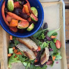 Bratwurst on salad w side of roasted veggies