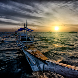 At Sunrise by Ferdinand Ludo - Transportation Boats ( nice sunrise, lovely, bantayan island, fishing boat )