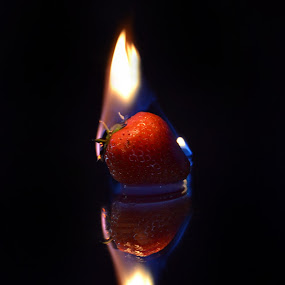 Strawberry Flames by Keri Stephenson - Food & Drink Fruits & Vegetables ( orange, reflection, flames, life, red, warm, blue, food, still, heat, strawberry, fire )