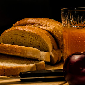 Breakfast Ready by Kamlesh Kumar - Food & Drink Plated Food ( fruit, bread, butter, food, breakfast, juice, kitchen, knife, plum )