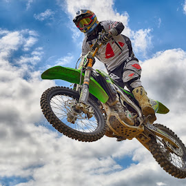 Dominating The Sky! by Marco Bertamé - Sports & Fitness Motorsports ( clouds, wheel, speed, green, dominating, 36, number, race, noise, jump, flying, sky, red, motocross, blue, cloudy, grey )