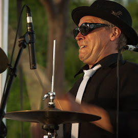 Bringing the Drums to Life by Garry Dosa - People Musicians & Entertainers ( civic holiday, concert, black & white, drummer, musician, entertainment, black )