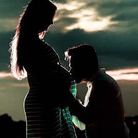 Expecting by Jesse Rodriguez Jr - People Maternity ( clouds, canon, kiss, maternity, silhouette, couple, lake, expecting )