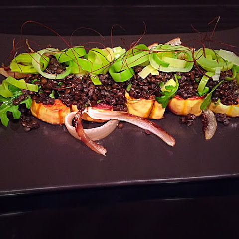 Delicata Squash with Black Lentils, Caramelized Onions and Leeks