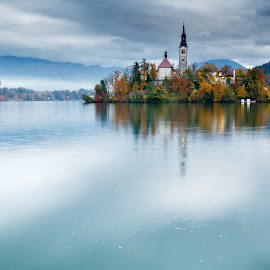 Autumn colours at Lake Bled by Ian Middleton - Landscapes Waterscapes ( famous, slovene, christian, reflection, europe, christianity, former, architecture, travel, attraction, historic, alpine, island, mountains, touristy, autumn, yugoslavia, bled, water, clouds, building, church, gorenjska, colors, beautiful, tourism, lake, scenic, shimmering, colours, holiday, history, slovenian, bell )