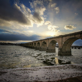 by Steven Maerz - Buildings & Architecture Bridges & Suspended Structures ( #bridge #sunset #river #winter #ice #water )