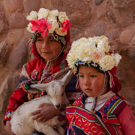 Dress Up For The Tourists by Janet Marsh - Babies & Children Child Portraits ( glasses, flowers, street scene, girls, goat,  )