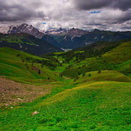 Dolomits by Ilan Abiri - Landscapes Prairies, Meadows & Fields ( mountains, vally, dolomites, green, clouds, gray, blue, white, skoies, houses, travel, landscape, meadow, italy )