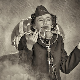 Retro Army show by Marco Bertamé - Black & White Portraits & People ( army, microphone, damp, singing, cap, lady, smoke )