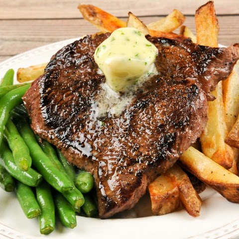 Brasserie-Style Sirloin Steak With Truffle Frites, Green Beans, and Herb Butter