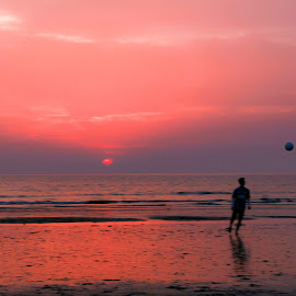 Hard work  by Shalini Jain - Landscapes Beaches ( shore, clouds, playing, shades, sky, levitation, silhouette, sunset, florecent, beach, landscape, soccer )